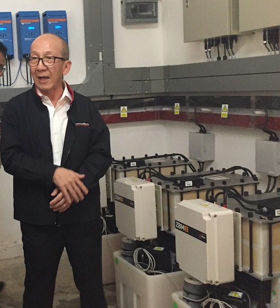 Thailand Energy Minister Dr Siri Jirapongphan with Redflow batteries at Ban Pha Dan