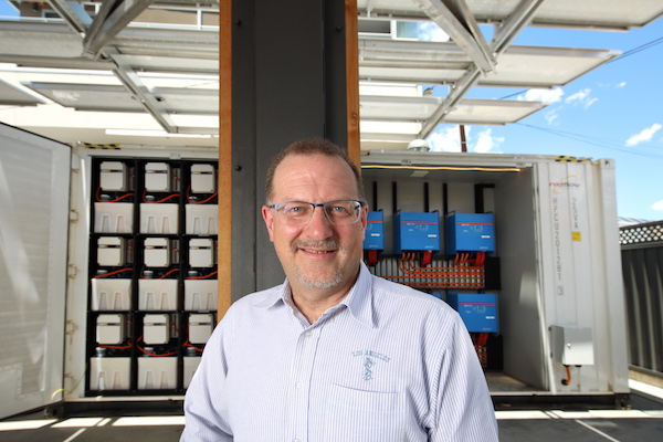 Simon Hackett in front of the redesigned LSB (Large Scale Battery) at Base64 in Adelaide